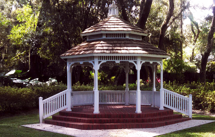 "Victorian Pavilion 21' (VK-21B) – Western Red Cedar Pavilion (6X6 constr.)with cedar shingles over lath on double-tiered roof, with three entrances and ascending rails for 24"" elevation, painted white"