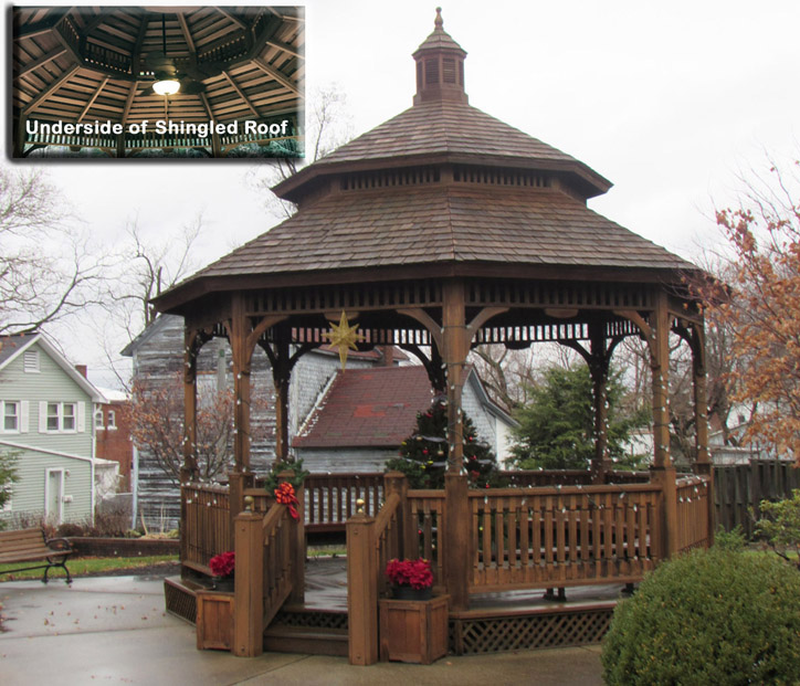 "Victorian Pavilion 21' (VK-21B) – Western Red Cedar Pavilions are 6X6 construction (Gazebos are 4X4 construction), shown is the cedar shingled double-tiered roof, floor with 12"" trellis and optional ascending rails, painted Sherwin Williams stain"