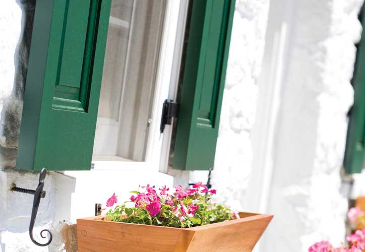 Window Flower Boxes and cedar shutters are a timeless combination.
