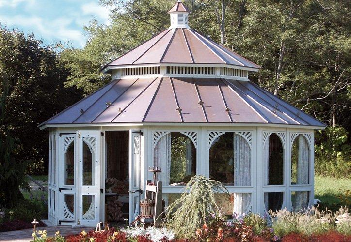 A large White screened Gardenhouse gazebo with Victorian inserts and two tier copper roof