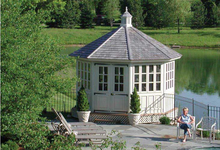 A 12 foot white gardenhouse with window enclosures