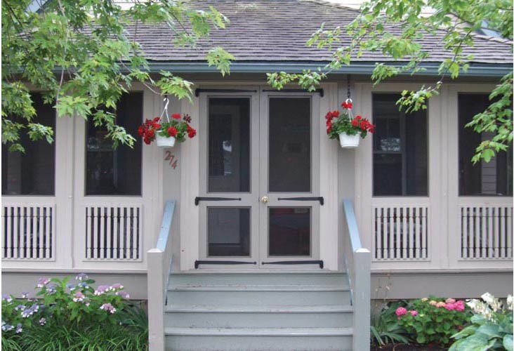 A porch enclosed by a Vixen Hill Porch System