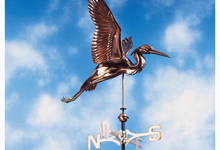 A bright copper Heron weathervane